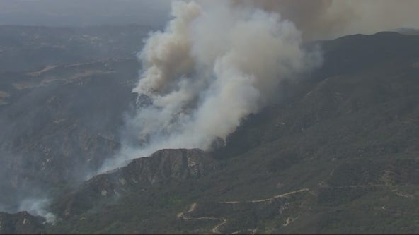 Crews battling Pacific Palisades brush fire scorching at least 100 acres, threatening homes