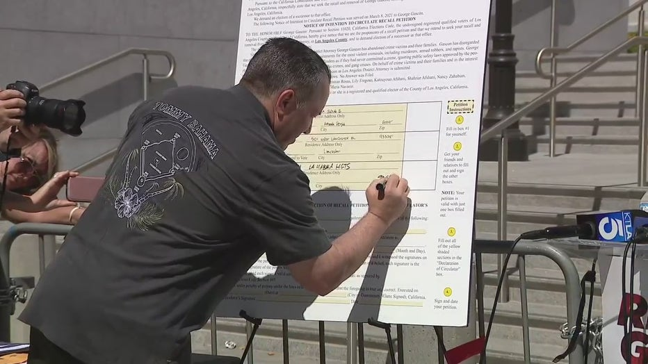 Sheriff Alex Villanueva signs the petition to recall LA County District Attorney George Gascón.