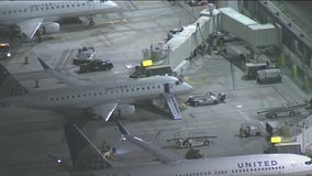Flight leaving LAX interrupted after passenger opens door, jumps onto taxiway
