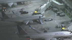 Man suspected of jumping out of LAX flight breaks leg, facing federal charges
