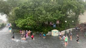 PHOTOS: Kids swim in flooded streets at Disney's Magic Kingdom