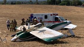 Plane crashes onto airport property in Riverside; 2 injured