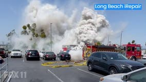 U-Haul truck possibly carrying chlorine burst into flames, prompts evacuation at a nearby Costco