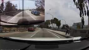 Dashcam captures man throwing metal rod at driver on Los Angeles freeway