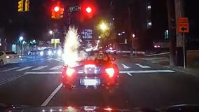 VIDEO: Driver burned after lit firework tossed into convertible