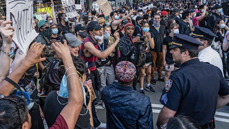 Protesters taunt police officers on the fourth straight day