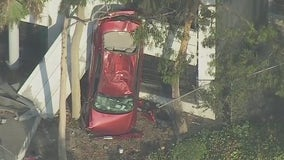 Car falls off parking garage in Downtown Los Angeles