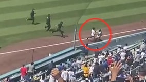 VIDEO: LA Dodgers' ball girl tackles pitch invader during crosstown rivalry game