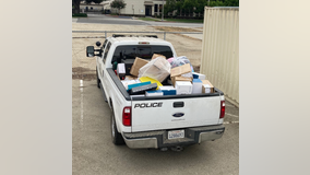 Over $100,000 in stolen property recovered from homeless encampment; suspect search underway