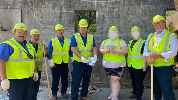 Ohio trash crew finds $25K family threw away while cleaning out freezer
