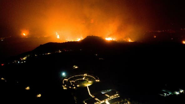 Birthplace of Olympics threatened as Greece battles forest fires