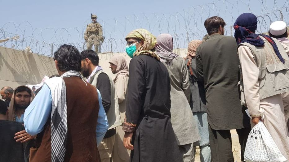 People continue to wait at Kabul's Hamid Karzai Airport