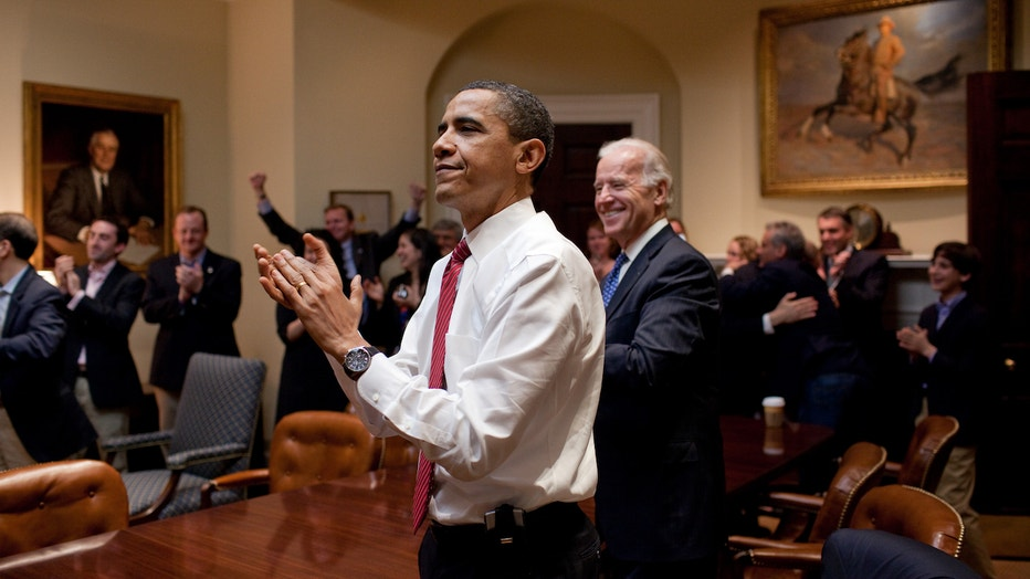 president-barack-obama-vice-president-joe-biden-and-senior-staff-applaud-in-the-roosevelt-room-of-the-white-house-as-the-house-passes-the-health-care-reform-bill.jpg
