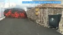 Video: Lava oozes down streets, ignites homes in Spain after volcano eruption
