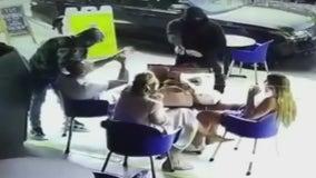 1 in custody, 2 on the run following brazen armed robbery at Fairfax District restaurant