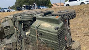 Five injured after military vehicle flips over on 215 freeway in Riverside County