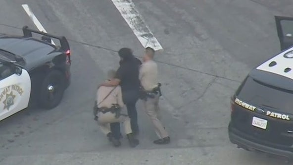 Video: Police chase suspect tries to fight off CHP officers arresting him