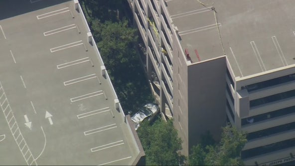 One dead after car plunges off parking structure in Orange