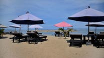 Bali reopens to some foreign travelers as COVID-19 surge subsides