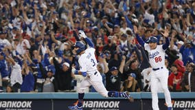 Dodgers' repeat bid stays alive after Chris Taylor's walk-off homer vs. Cards