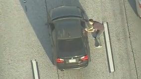 Suspect walks on freeway, carjacks BMW, leads deputies on chase, hides in hotel