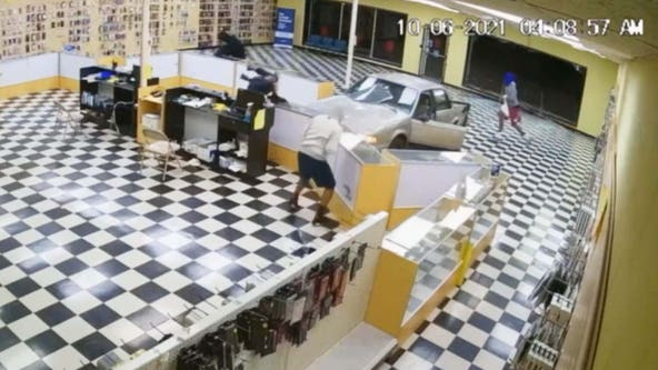 Bold burglars caught on video crashing car into storefront to steal merchandise