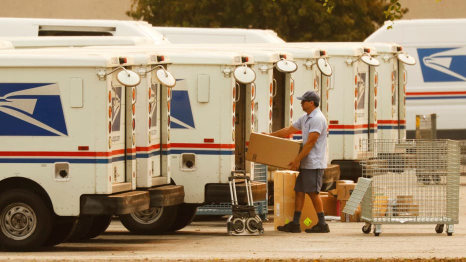 db7c0c87-Mail carriers loading their trucks at the United States Postal Service in Van Nuys, California for story on USPS delays