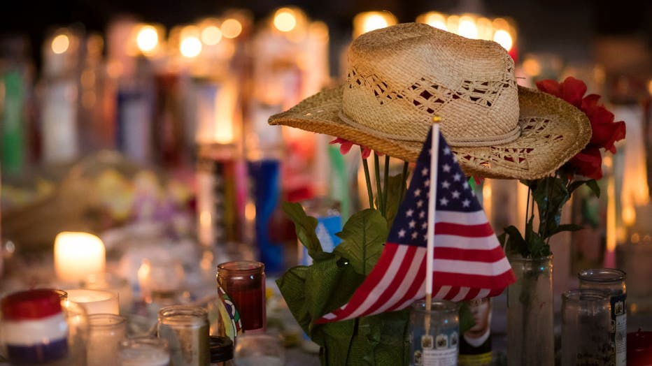 FILE - A hat is left at a makeshift memorial during a vigil to mark one week since the mass shooting at the Route 91 Harvest country music festival on Oct. 8, 2017, in Las Vegas, Nevada. (Photo by Drew Angerer/Getty Images)
