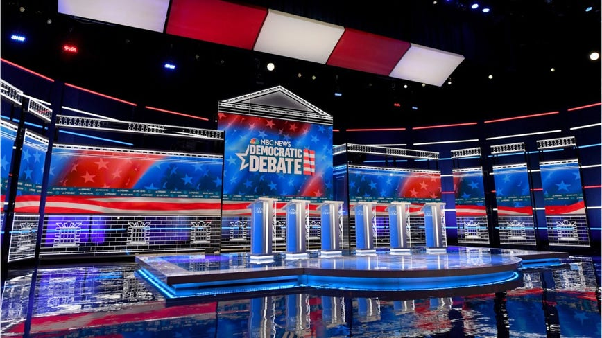 Democratic debate: Candidates take aim at Bloomberg's record minutes into event