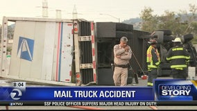 Overturned mail truck slows 101