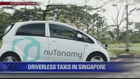 Driverless taxis debut in Asia