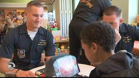 Marines take time out of Fleet Week to visit sick children in hospital
