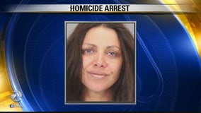 Woman arrested in slaying