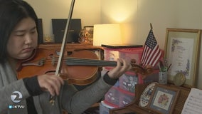 Violinist expresses herself through music and food