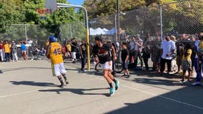 Steph Curry plays basketball with 'random dude' in Oakland during Mistah F.A.B. backpack giveaway