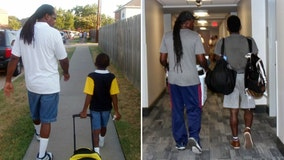 Dad walks son to first day of kindergarten, first day of college