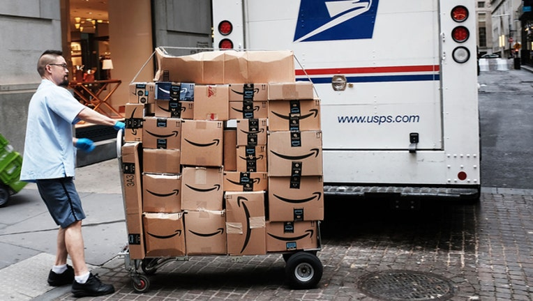 aba9d1ce-AMAZON-BOXES-DELIVERY-GETTY_1544644722345-401720.jpg