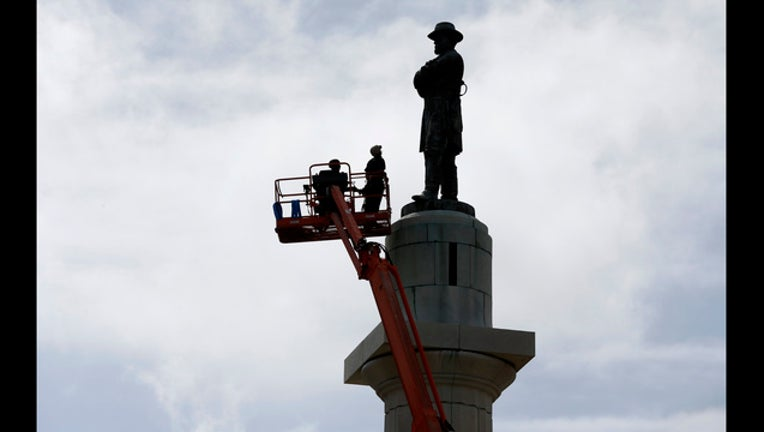 5620f3ed-CORRECTION APTOPIX Confedrate Statues New Orleans_1495235260717