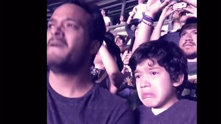 53cb0062-Boy with autism overcome with emotion at Coldplay concert, 1-402970