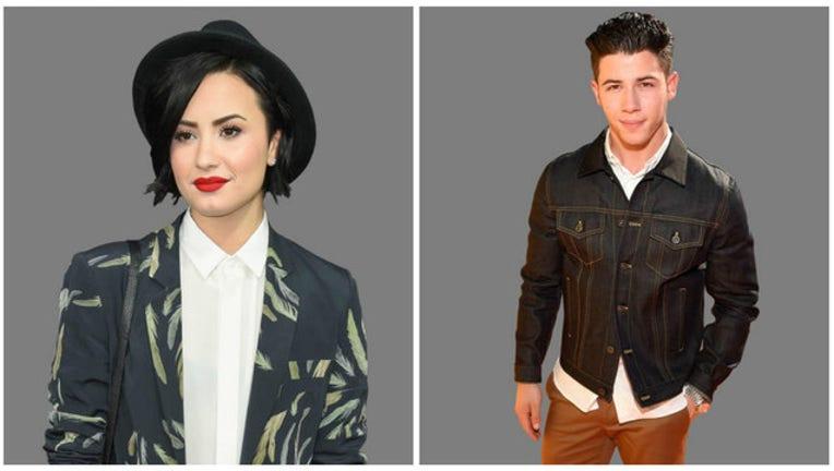 274e1fc1-Demi_Lovato_Nick_Jonas_1461620943608.jpg