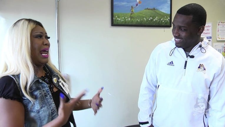 ECU coach gives surprise mother's day gift_1494598052742-403440.jpg
