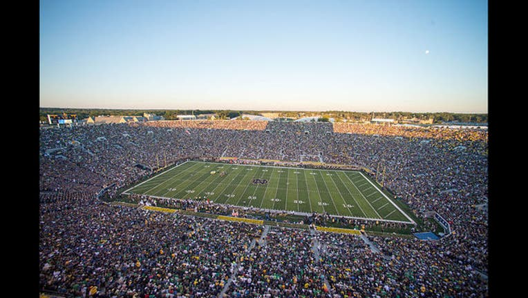 fa48a0af-Fans_and_players_gather_for_a_football_game_Sept._6,_2014,_at_Notre_Dame_Stadium_in_South_Bend,_Ind_140906-D-KC128-220_1471714452437.jpg
