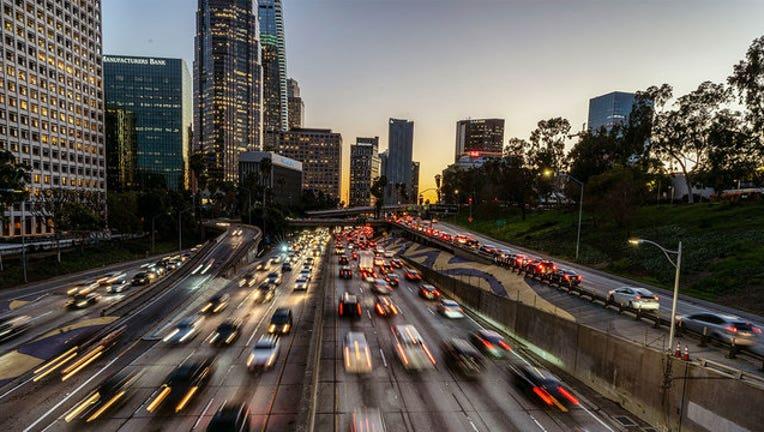 a0a57e79-GETTY-Los-Angeles-Traffic-drivers-driving-downtown-la-L.A.-los-angeles-skyline-100-freeway_1561994742676-407068.jpg