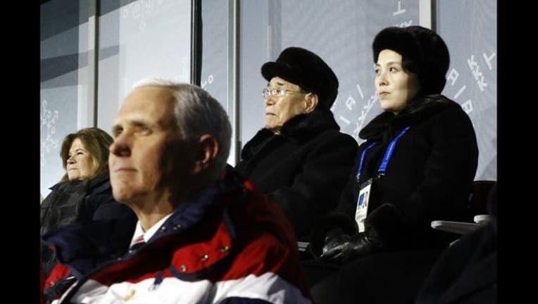 9efb5e12-Kim Jong Un sister behind Pence GETTY-409162