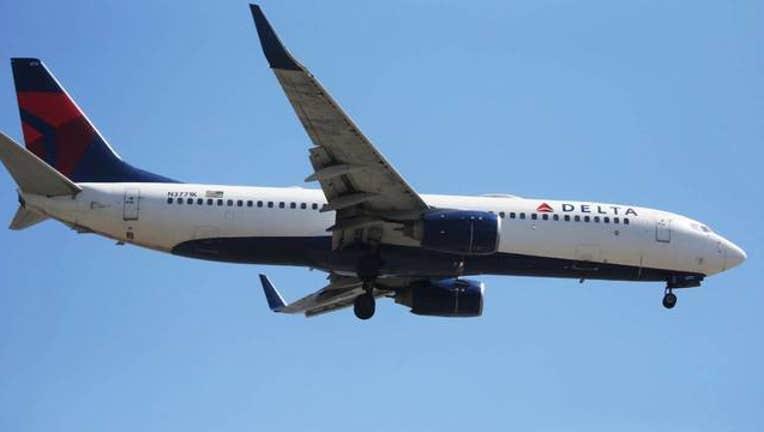 60544052-Getty Delta Airlines Plane_1554725282872.jpg-408200.jpg