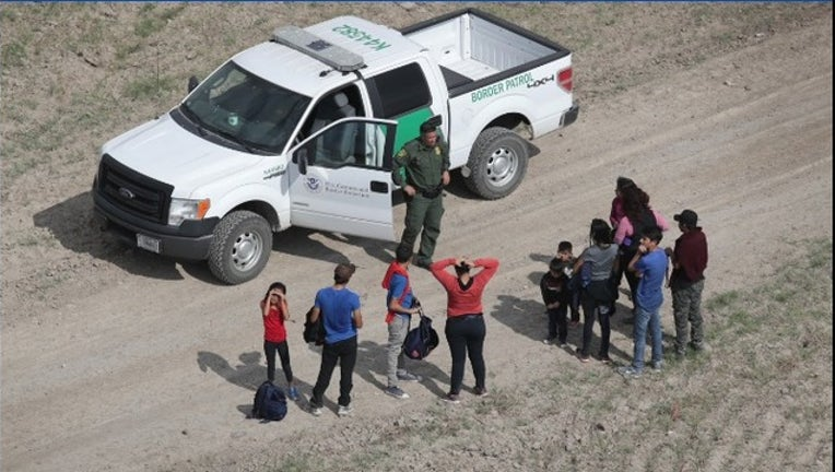 33568ec1-Getty asylum seekers_1541803285663.PNG.jpg