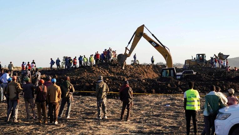 e0b367f2-GETTY Ethiopian Airlines crash site 031119-408200-408200