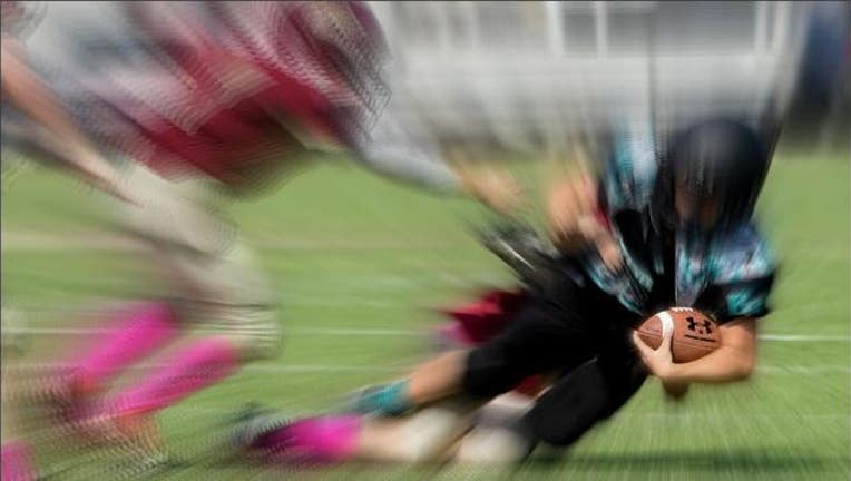 b8c45d92-Kids playing football image by C Watts via Flickr-404023