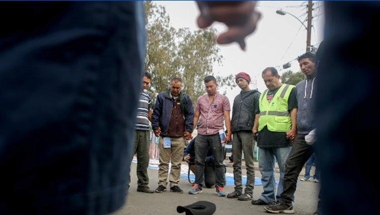 a46b38ed-Migrant caravan Tijuana_1543178379040.PNG.jpg