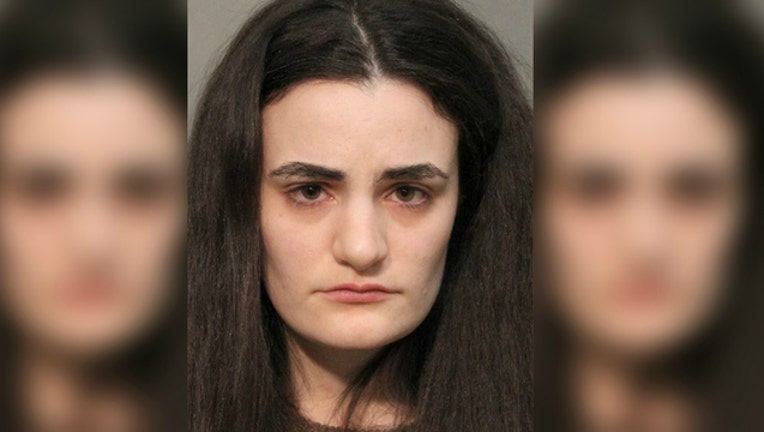 9fa8d36e-Keri Karman is accused of attacking a noisy toddler at a movie with popcorn-404023